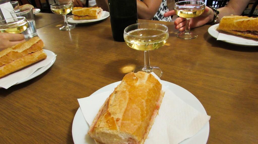 Catalan butifarra sausage sandwich and cava for breakfast in Gracia, Barcelona - Devour Barcelona Food Tours