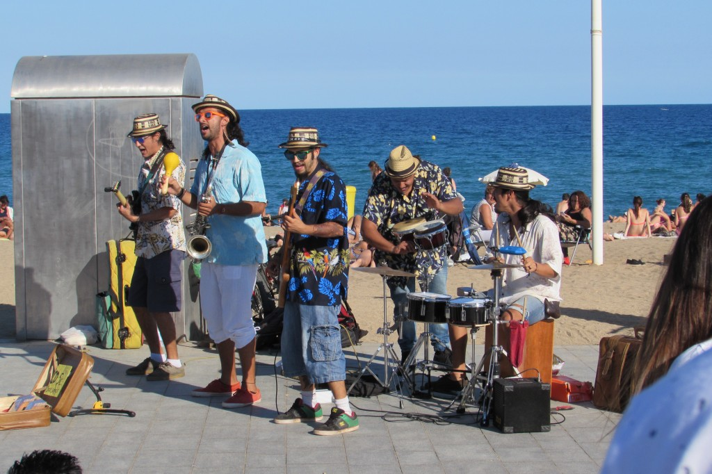 Live cuban music band playing at Barceloneta beach Barcelona