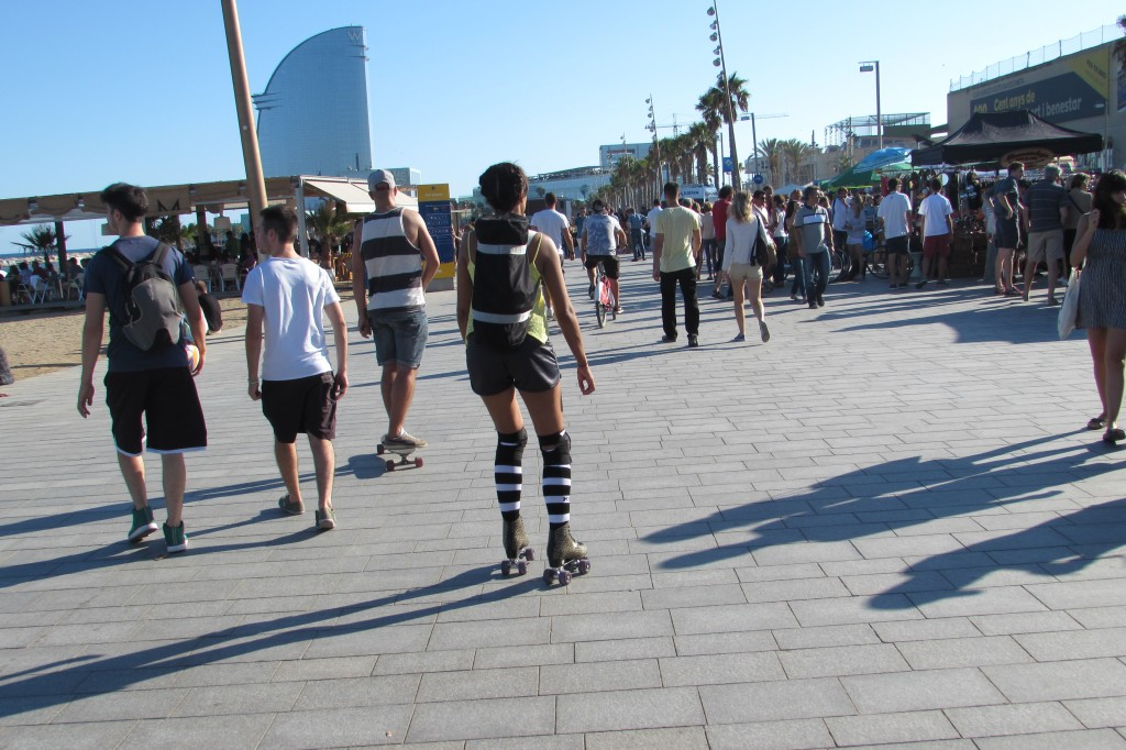 Rollerblading along boardwalk at Barceloneta beach Barcelona