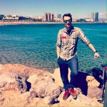 Ben Holbrook travel and food blogger at the beach in Barcelona