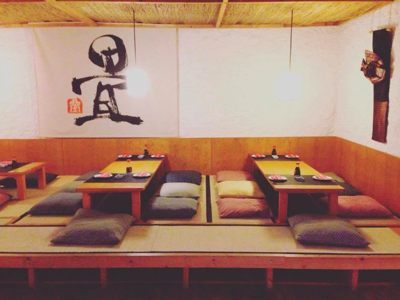 Tatami mats where guests take off their shoes to eat authentic sushi, and ramen at The Tatami Room in Barcelona