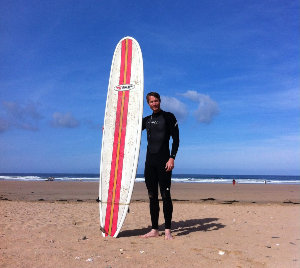 Me back in the day, before surfing at Newquay beach, Cornwall