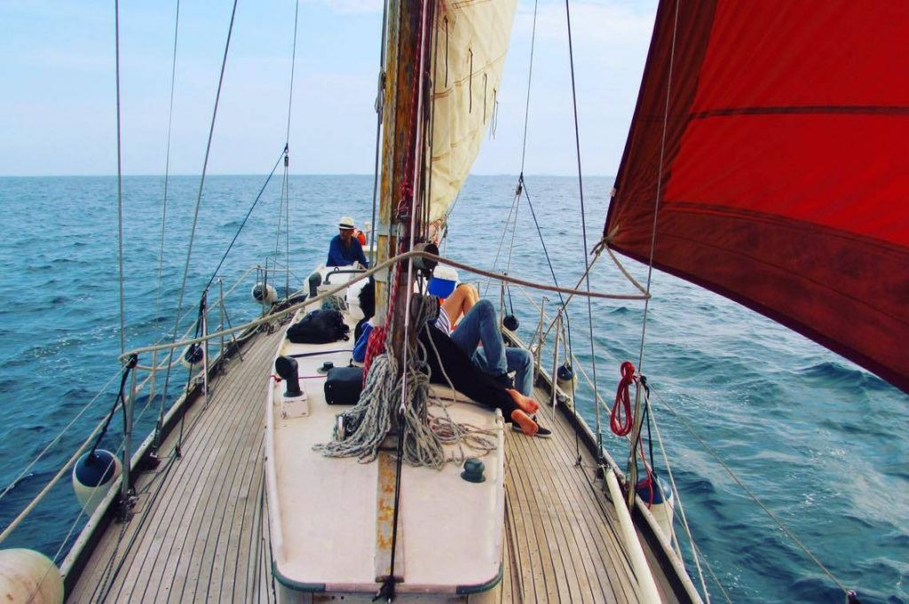 Me and my friends on a wooden sailboat called Gemini in Barcelona