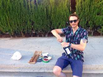 Ben preparing to picnic at sunset in Parc Joan Miró ~ Credit Ben Holbrook