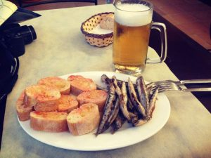 Pescaditos (little fried fish tapas) and a jug of beer and Camping Begur, Costa Brava