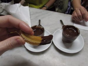 Proper Spanish churros dipped in thick chocolate on the Wanderbeak food tour in Barcelona