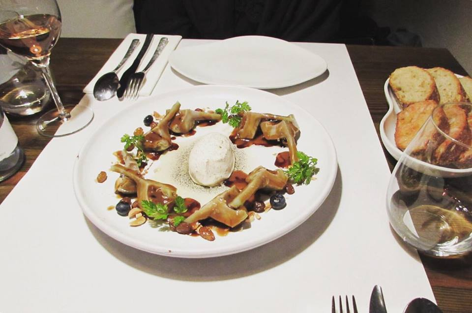 Artichoke salad at Compartir restaurant in Cadaques, Costa Brava, Catalonia, Spain