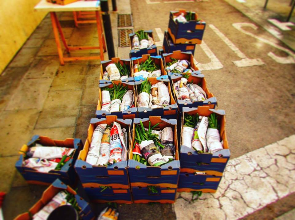 Boxes of Calcots waiting be be barbecued in Sants, Barcelona Calcotada