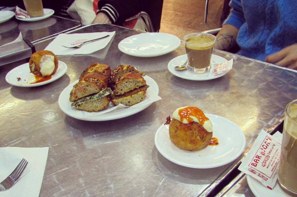 Bombas for breakfast at Bar Joan in the Santa Caterina food market in Barcelona - Barcelona Food Sherpa Market Tour and Home Dining Experience
