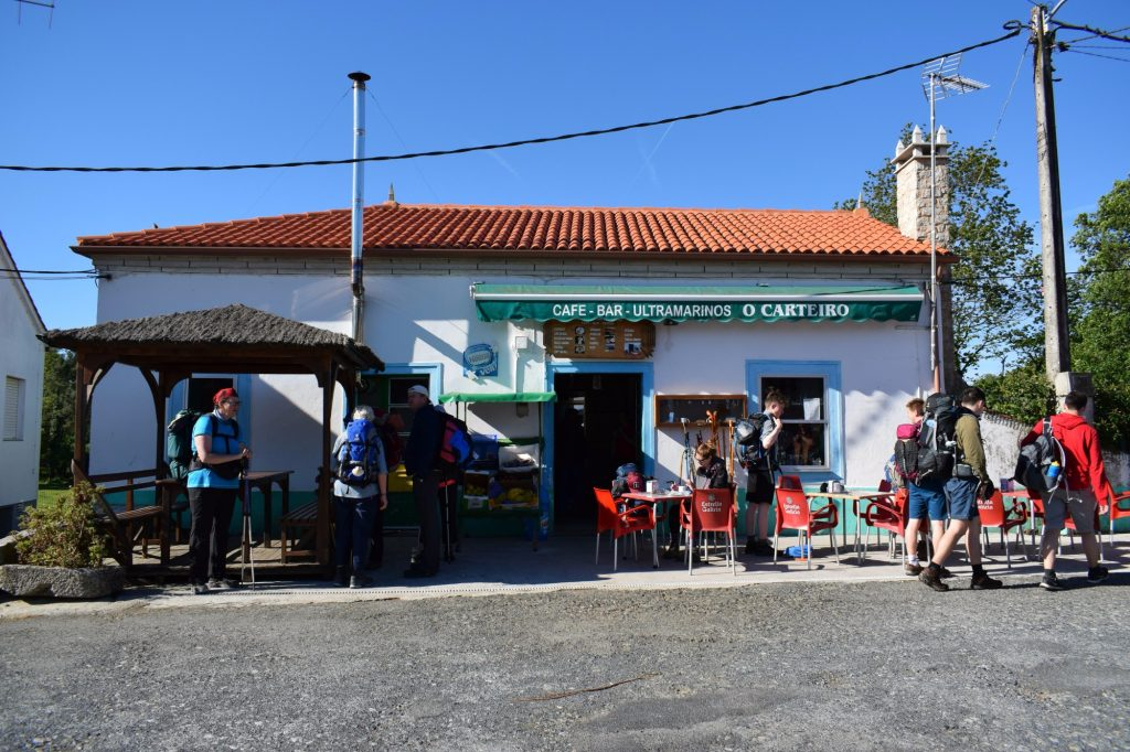 Hikers resting at a Hospitalero (cafe bar) along the Camino de Santiago in Galicia