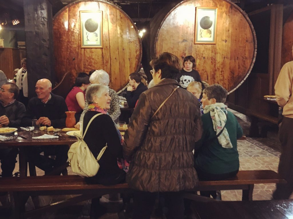Hustle and bustle at Petritegi sagardotegi cider house near San Sebastian in the Basque Country
