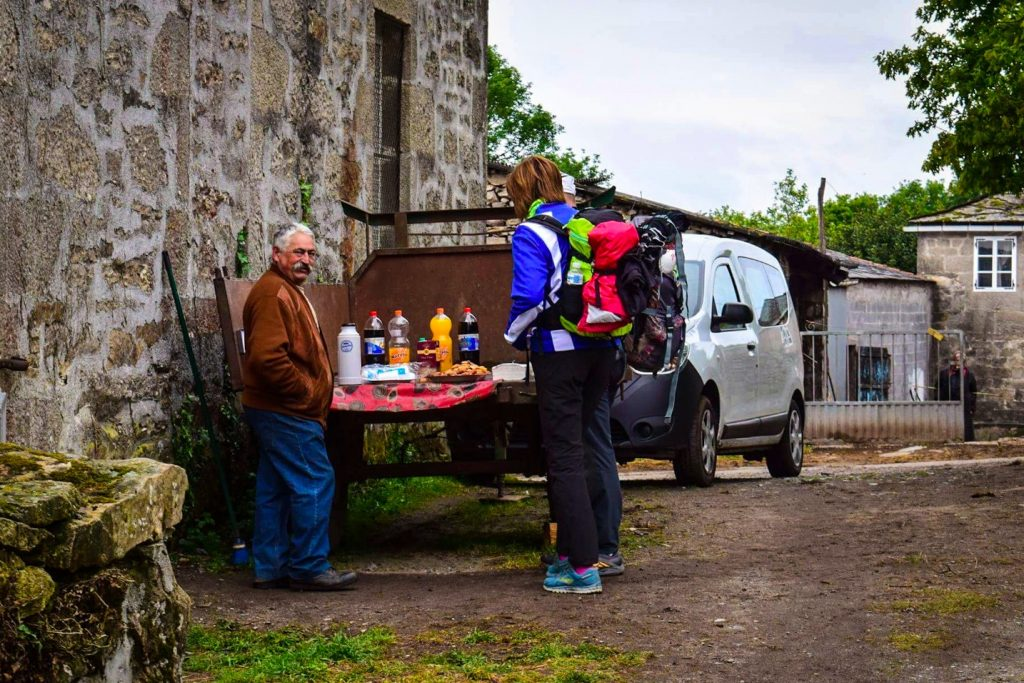 Farmers selling food and drinks from a trailer on the Camino de Santiago