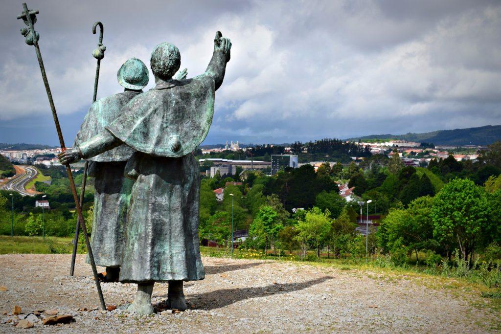 the Pilgrims Statue Looking at the cathedral de santiago de compostela