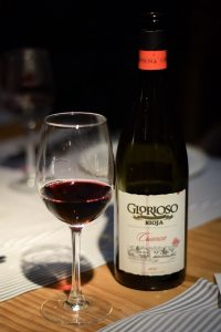 A glass and bottle of Spanish Rioja red wine - Barcelona Food Experiences Food Tour