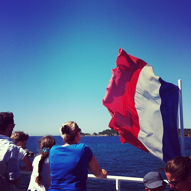 The French flag flying off the back of a ferry going from Hyeres to Porquerolles Island in the south of France