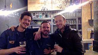 Ben Holbrook travel writer with the owners of Garage Beer Co. craft beer bar Barcelona