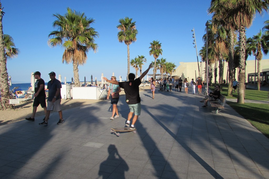 Longboard skateboarding at beach in Barcelona