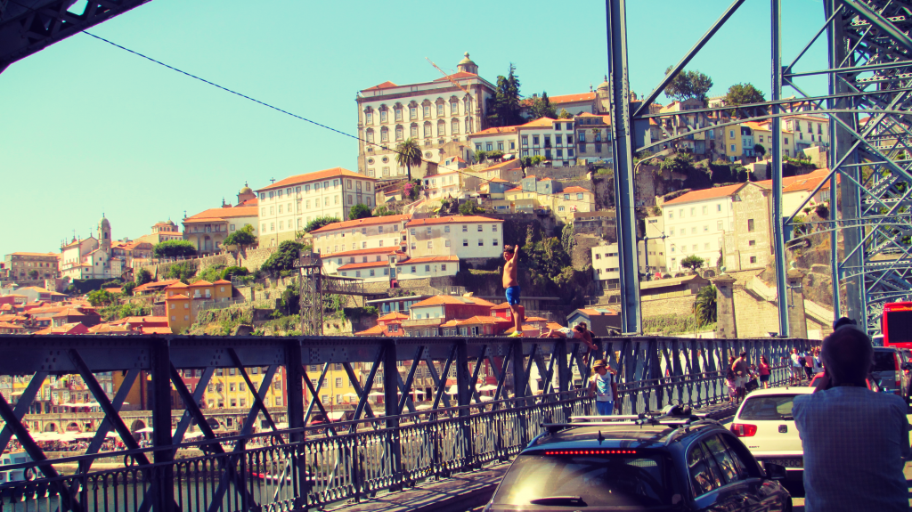 Kids Jumping off Dom Luís I Bridge in Porto, Portugal by Ben Holbrook