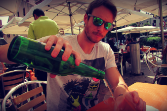 Celebrating the summer with a splash of cider, in Gijón, Asturias (northern Spain)
