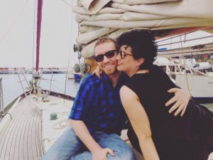 Couple enjoying a sailing trip in Barcelona