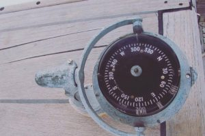old compass on an old sailboat