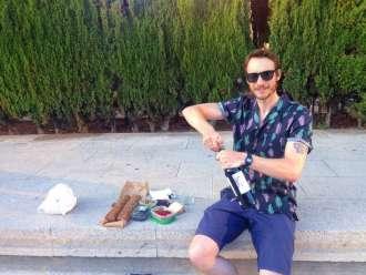 Ben preparing to picnic at sunset in Parc Joan Miró ~ Credit Ben Holbrook