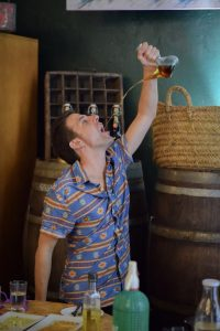 Drinking wine from a Spanish purron bottle - Barcelona Food Experiences Food Tour