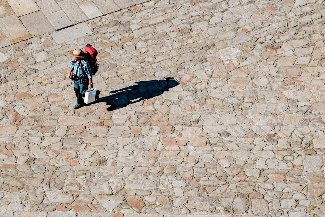 Pilgrims arriving in Praza do Obradoiro, Santiago de Compostela, Galicia, Northern Spain