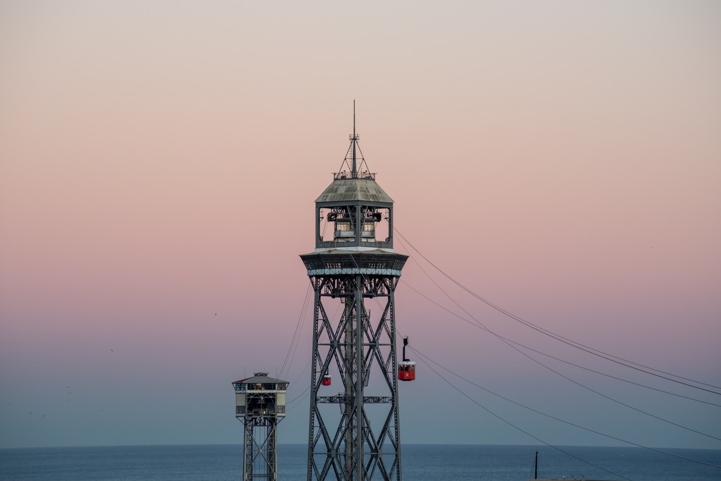 Barcelona's iconic cable car at sunset