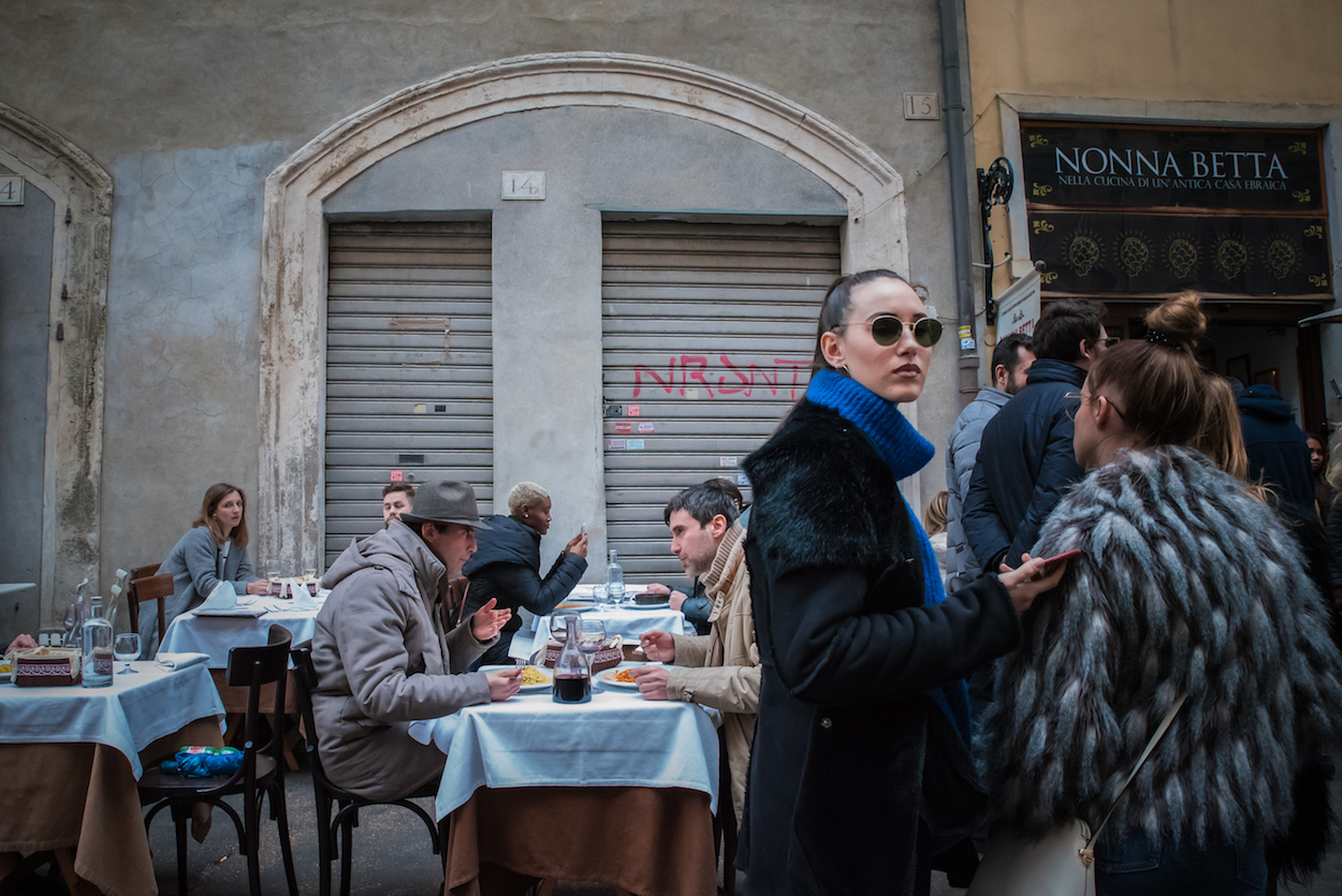 Lunchtime on Via del Portico d'Ottavia in Rome's Jewish Ghetto - by Ben Holbrook.