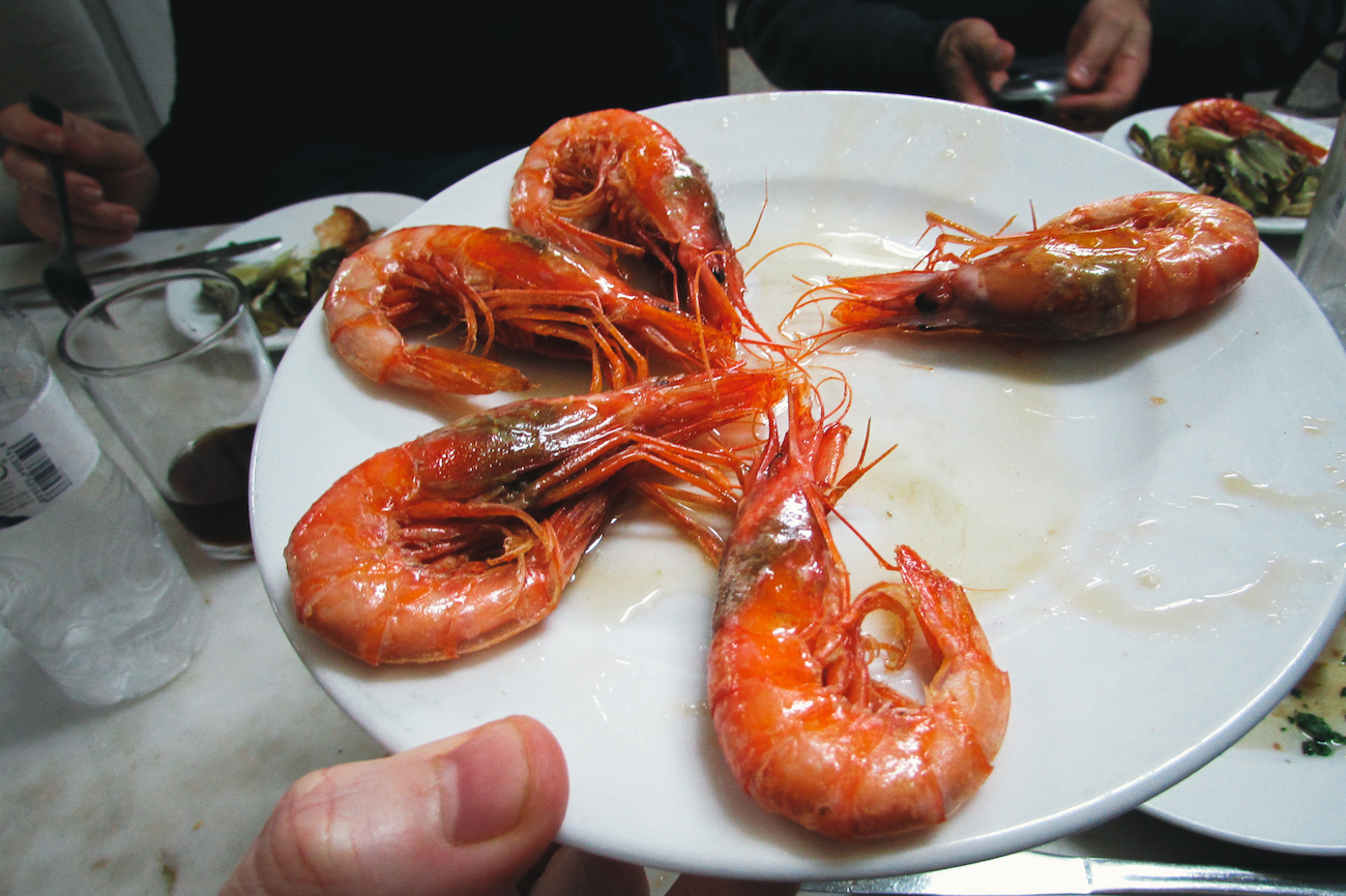 Eating gambas / prawns on the Barcelona Food Lovers Food Tour in Barceloneta - by Ben Holbrook