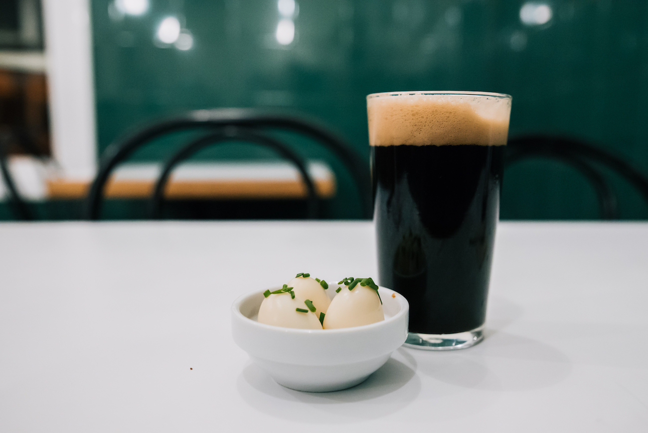 pickled quails eggs and a Edge Brewing porter at The Pie Shoppe in Gracia, Barcelona