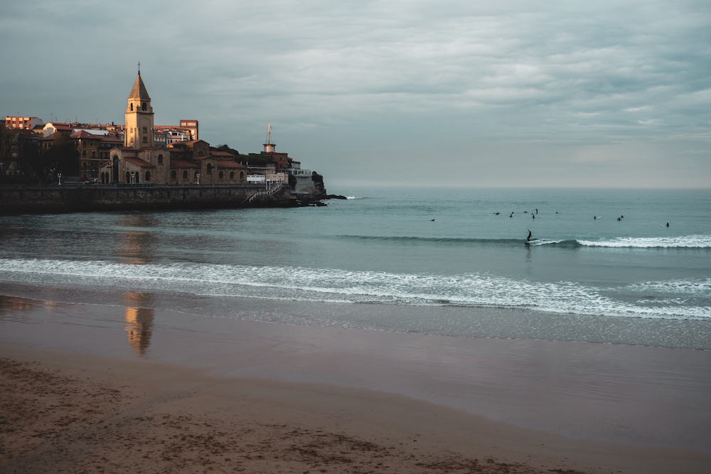 Surfing at dusk. Gijon. Asturias, northern Spain - by Ben Holbrook from DriftwoodJournals.com
