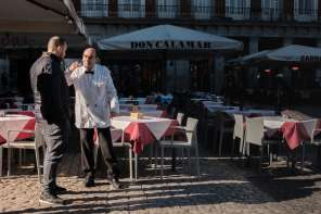 Old fashioned white-coated waiter in Local life in Plaza Mayor, Madrid Street Photography Essay - by Ben Holbrook DriftwoodJournals.com
