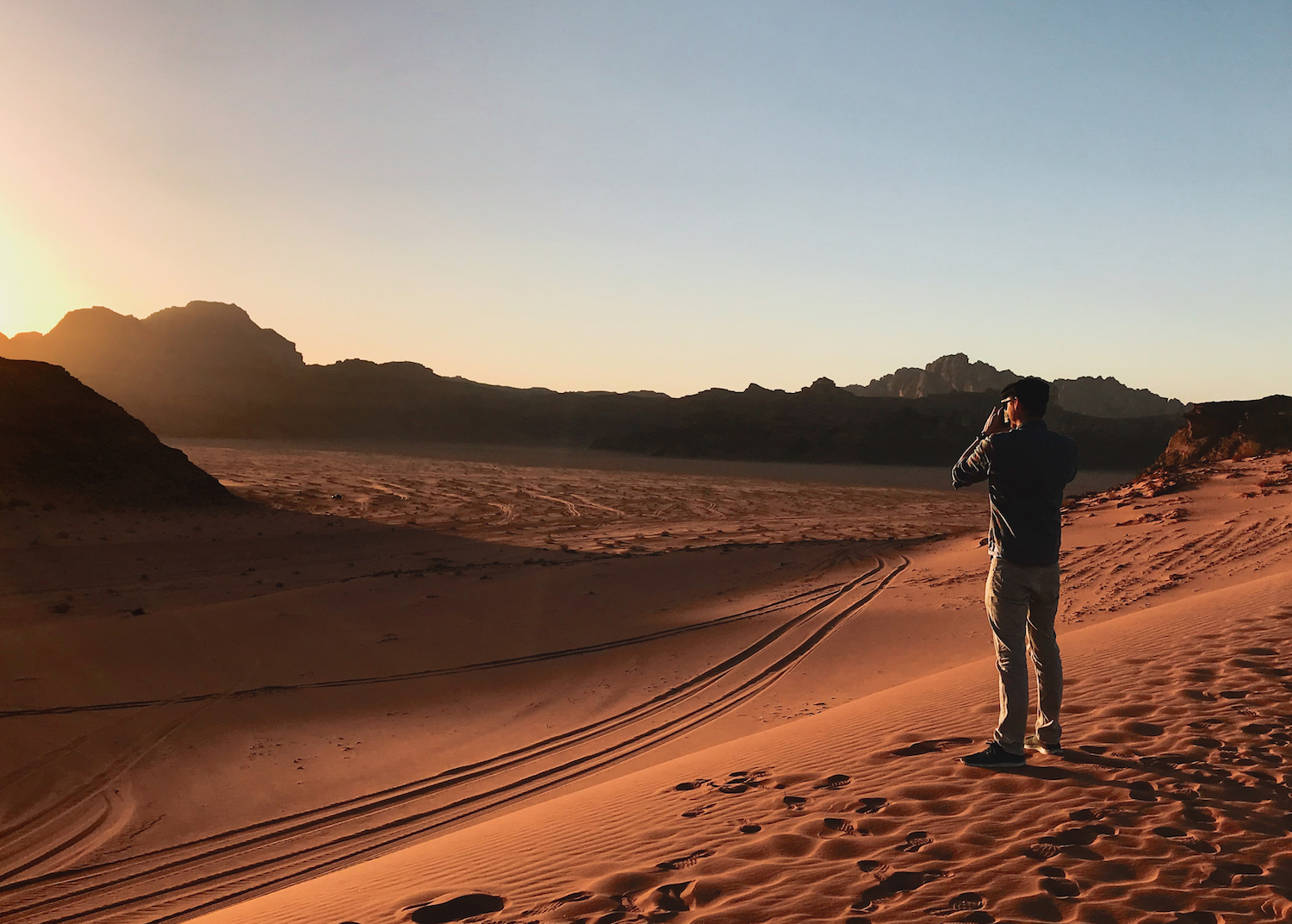 Sunset in Jordan's Wadi Rum desert - by Ben Holbrook from DriftwoodJournals.com.