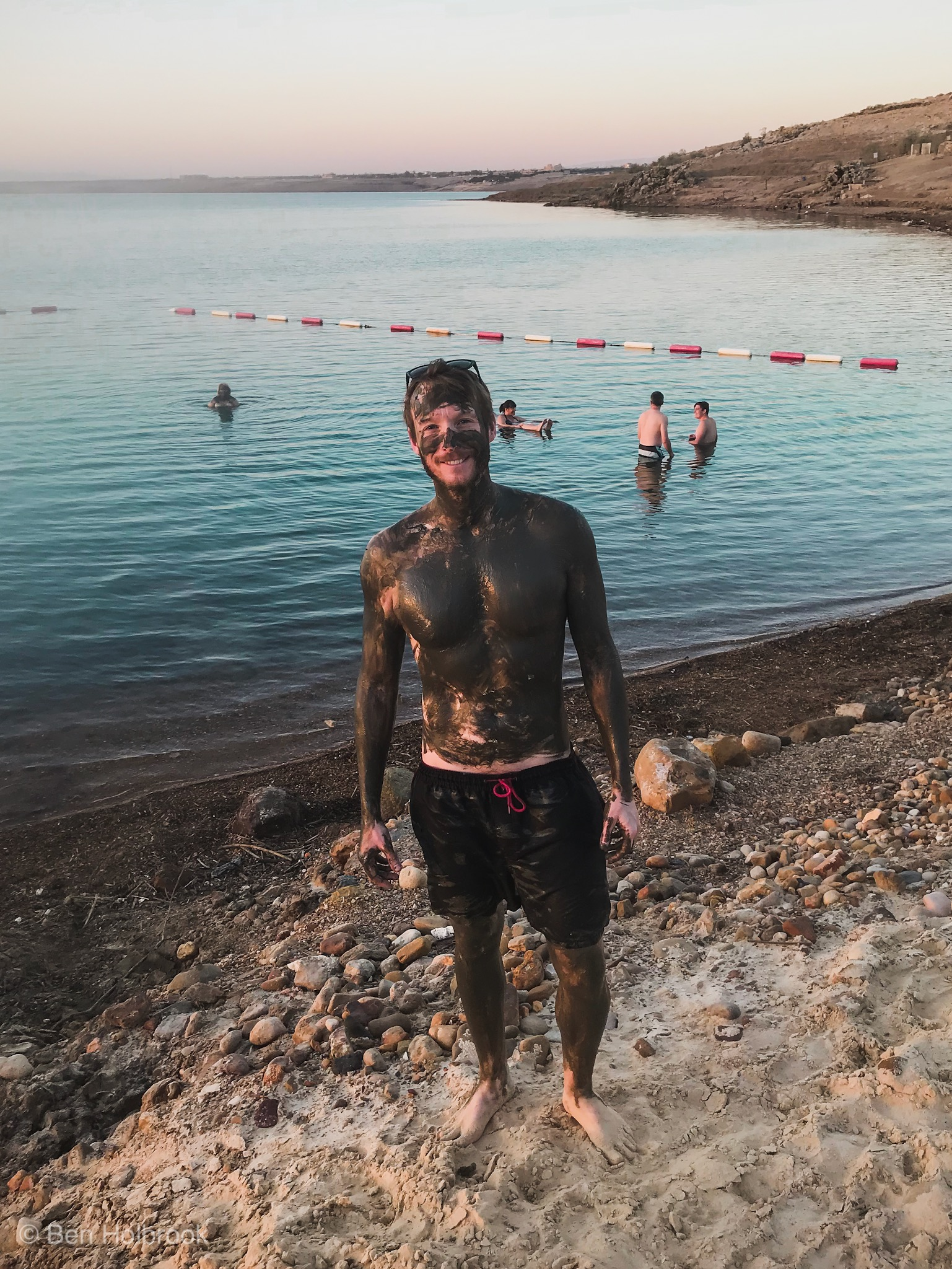 Ben Holbrook mud bath and bathe, Dead Sea, Jordan.