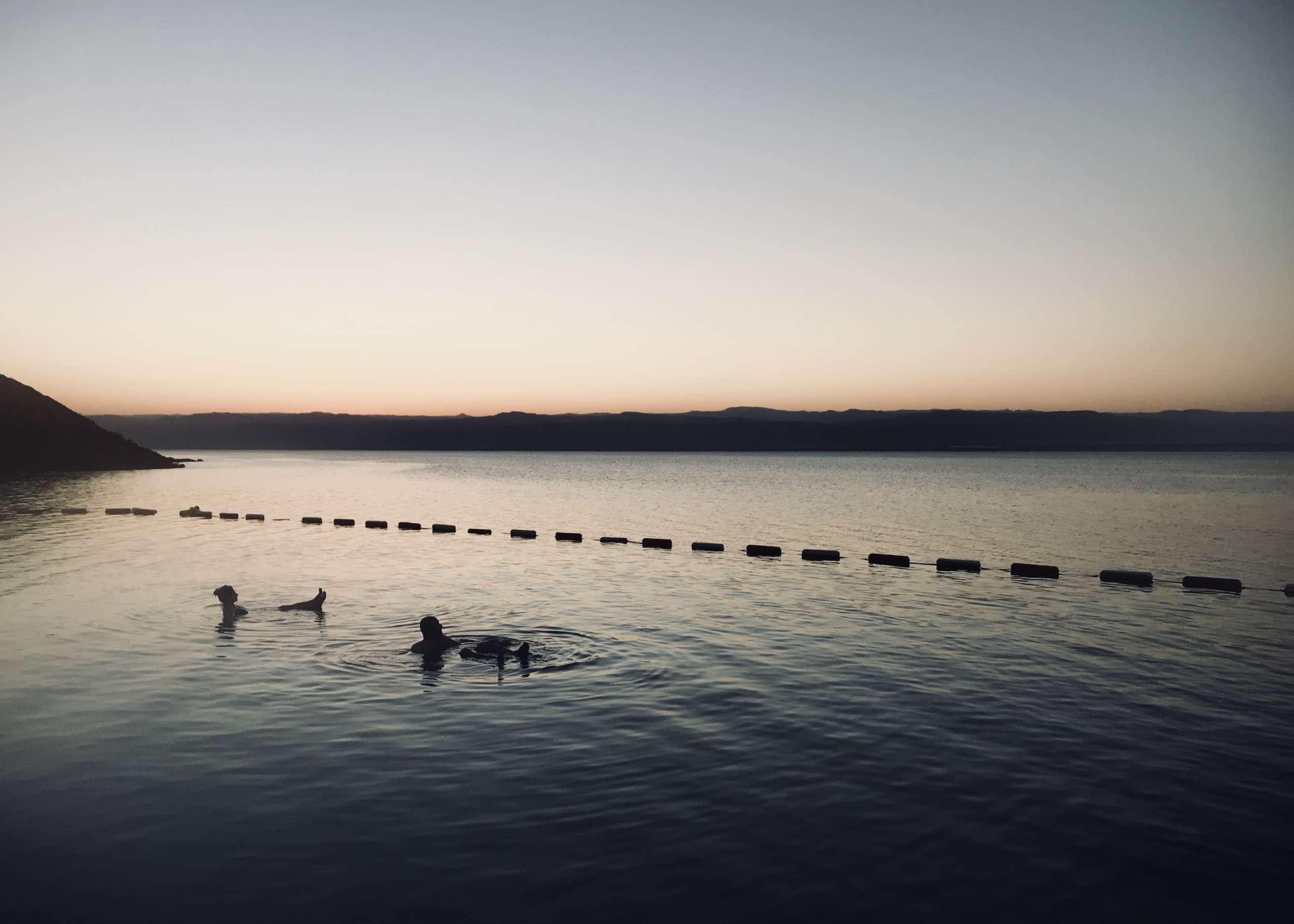 floating in the Dead Sea, Jordan.