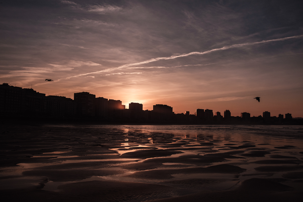 sunset on San Lorenzo beach, Gijon, Asturias, northern Spain - by Ben Holbrook from DriftwoodJournals.com