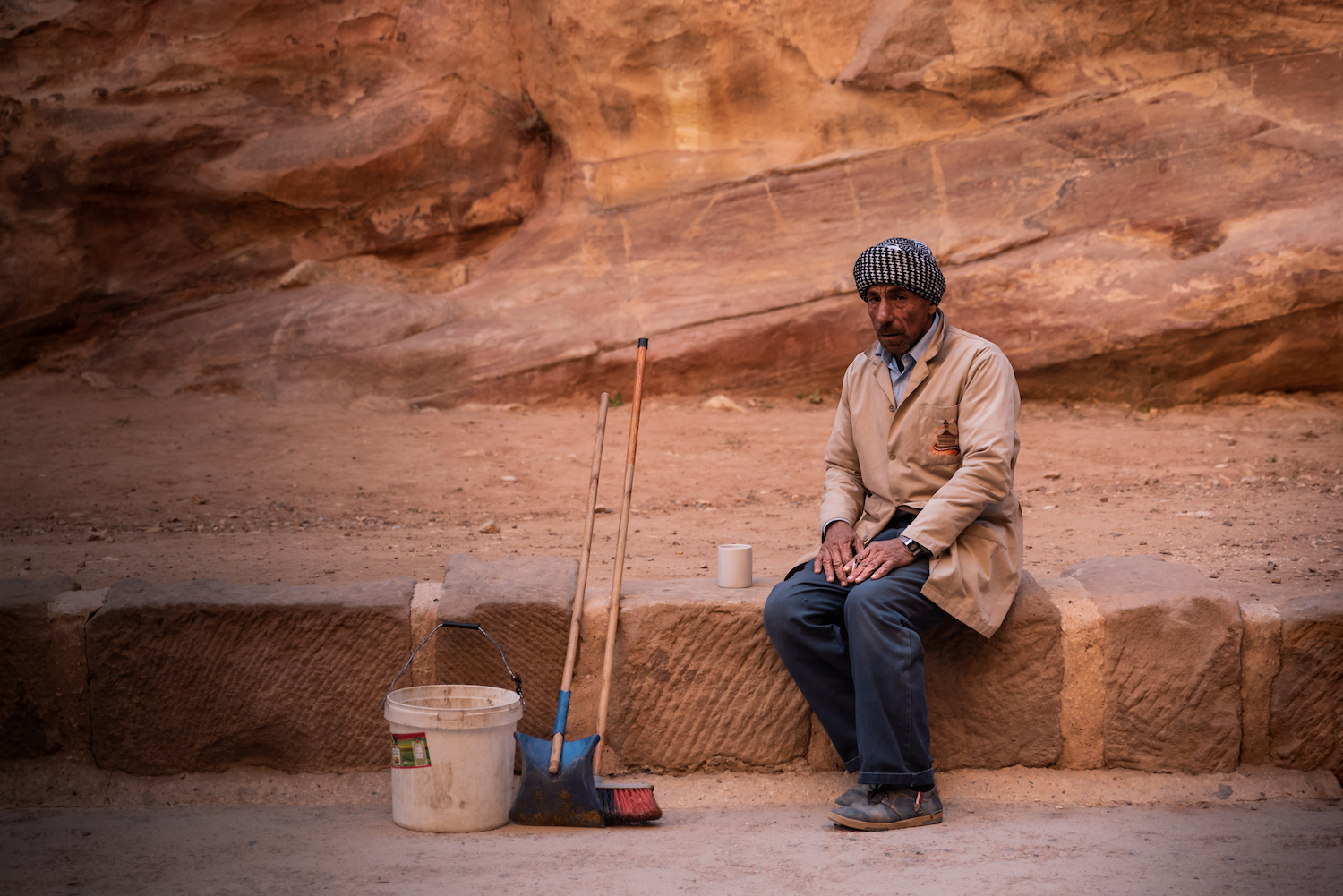 Petra groundsman stops for a smoke. - by Ben Holbrook from DriftwoodJournals.com