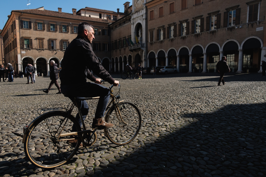 Cyclist in Piazza Grande Modena, Italy Street and Travel Photography by Ben Holbrook from DriftwoodJournals.com-4813