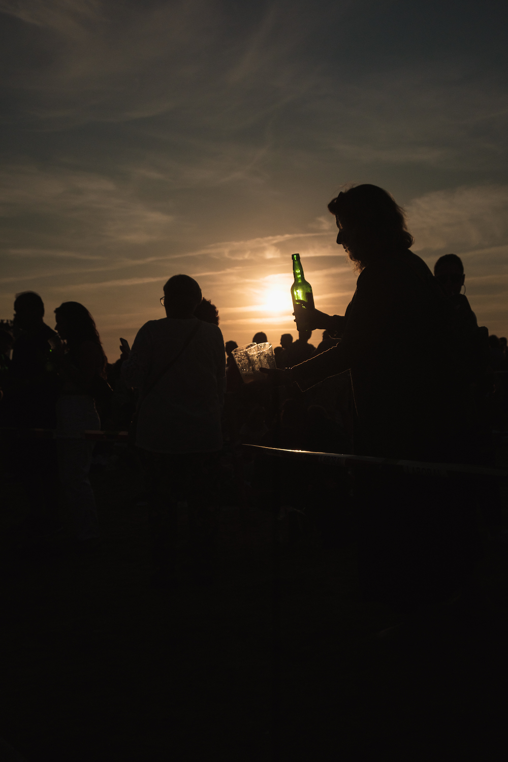 Sidra pouring world record at sunset in Gijon, Asturias, northern Spain by Ben Holbrook from DriftwoodJournals.com