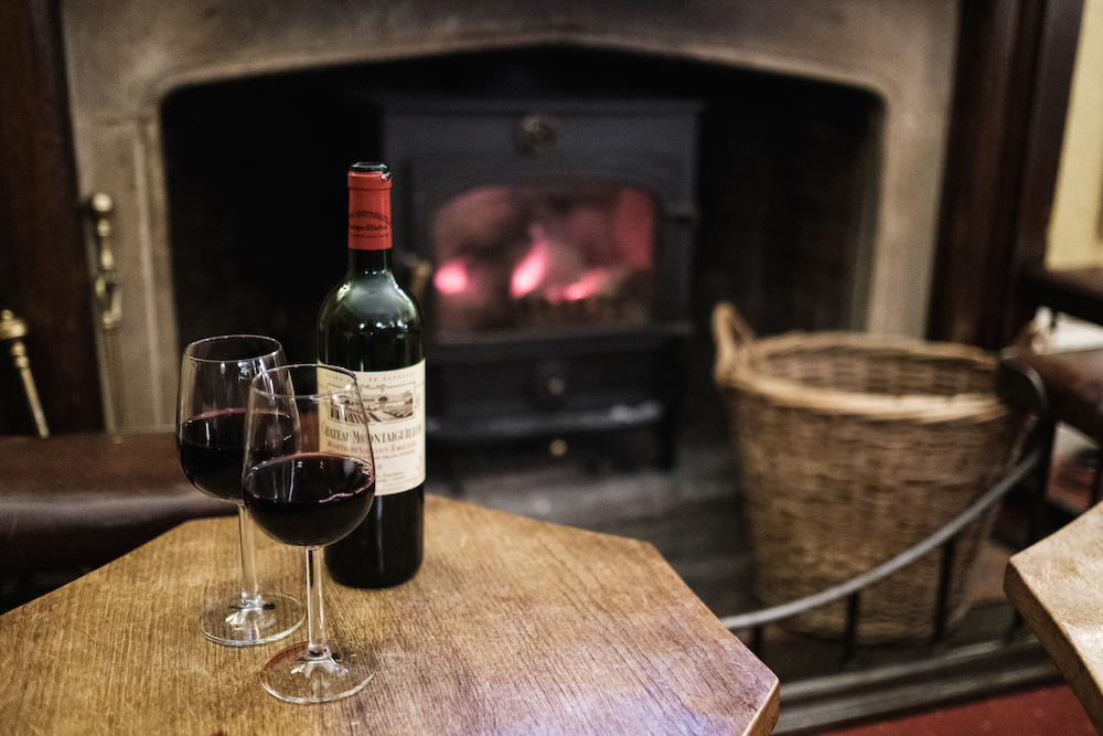 Drinking wine by the fire at Gliffaes Country House Hotel | Crickhowell, Wales, UK - Travel Photography by Ben Holbrook from DriftwoodJournals.com-6499