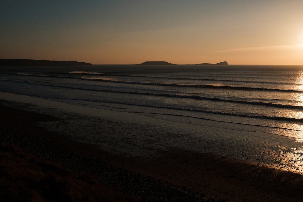 Sunset over the waves at Llangennith Beach, Gower Peninsula South Wales, UK - Landscape Photography by Ben Holbrook-9